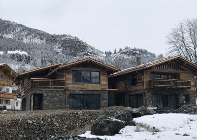 Naturstein Geopietra Holzhaus Berge von ks-ofenbau